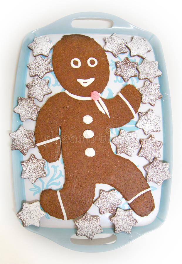 Gingerbread doll with chocolate and stars. Gingerbread doll with chocolate and chocolate stars with sprinkled sugar stock images