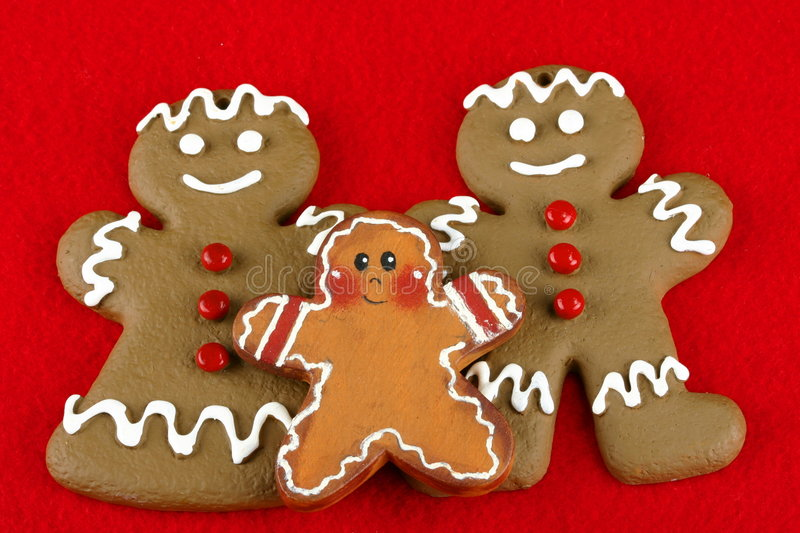 Gingerbread Family. Isolated on red space with room for text royalty free stock photography