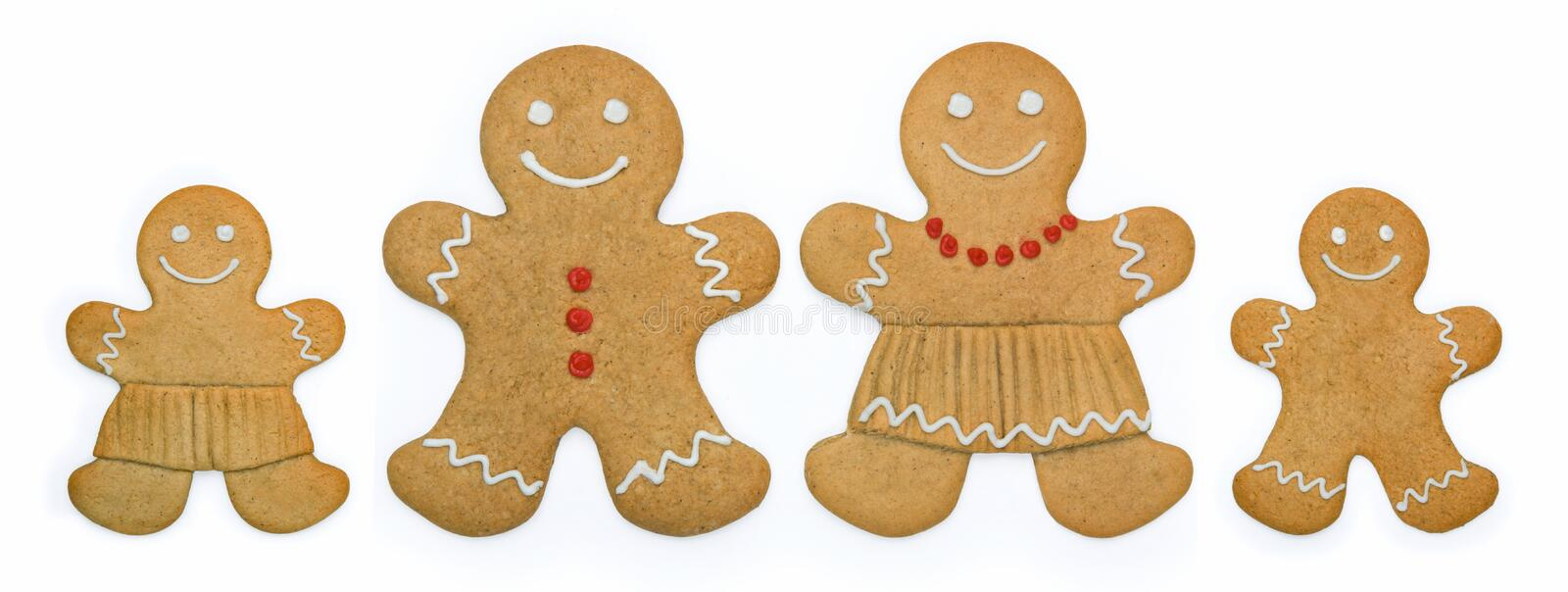 Gingerbread family. Smiling gingerbread family stand in a row stock photos