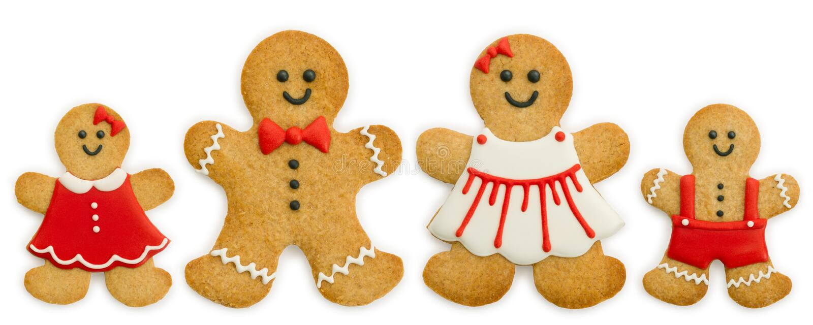 Gingerbread family. Against a white background royalty free stock photo