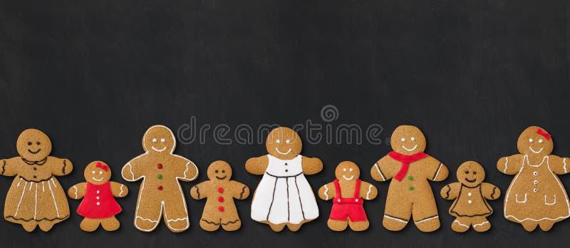 Gingerbread family. On a blackboard stock photo