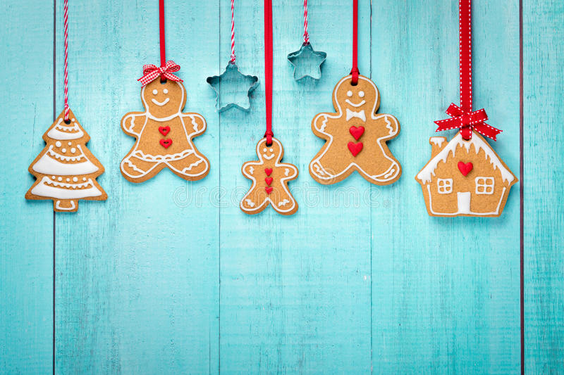 Gingerbread family border. Happy Gingerbread family hanging border on blue background royalty free stock photography