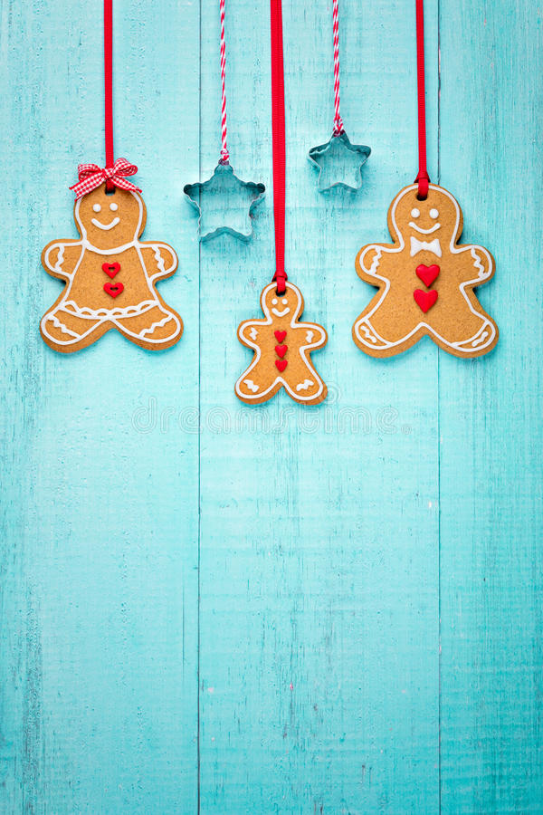 Gingerbread family border. Happy Gingerbread family hanging border on blue background stock photography