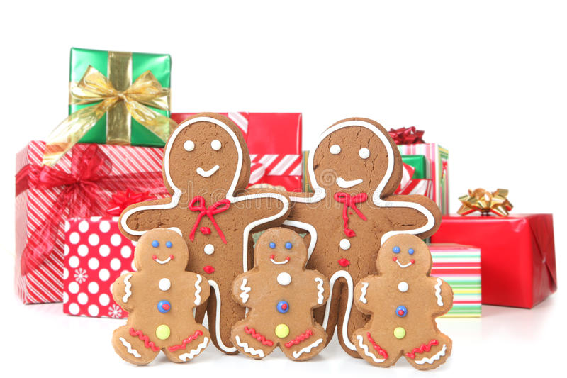 Gingerbread Family at Christmas Time. Adorable Gingerbread Family Against Holiday Wrapped Christmas Gifts royalty free stock image