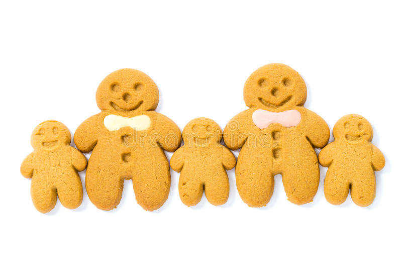 Gingerbread family cookies. Isolated on white stock images