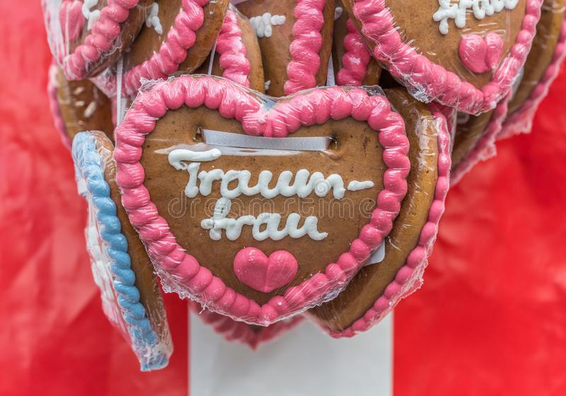 Gingerbread hearts at a folk festival with German words – dream woman, Germany.  stock image