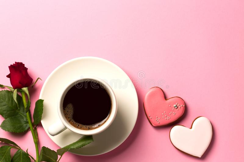 Valentine day background with hearts, roses and a cup of coffee. Top view with space for your text royalty free stock images