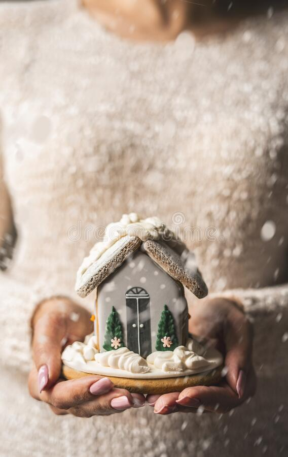 Gingerbread house in beautiful female hands. royalty free stock photography