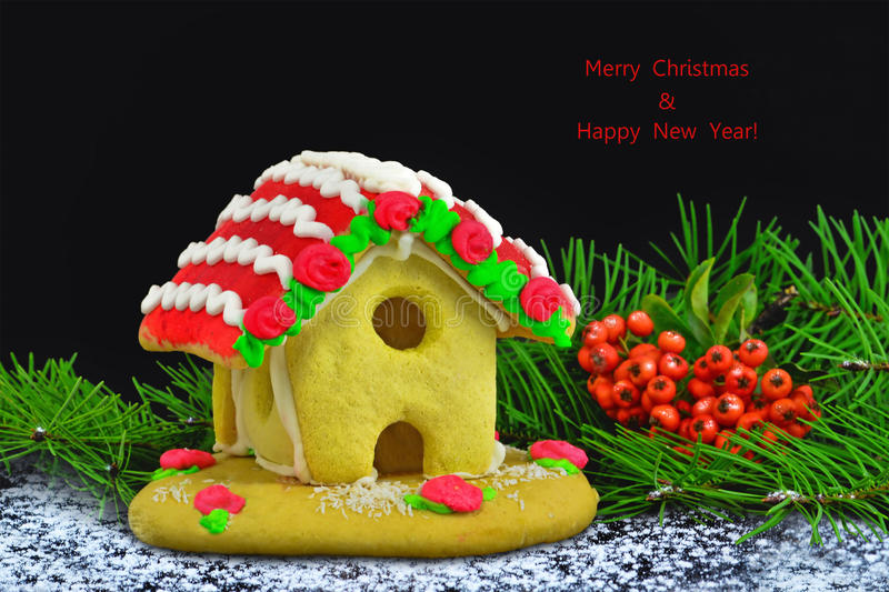 Gingerbread house Christmas greeting card on black stock photo