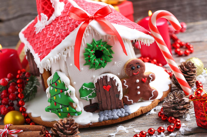Gingerbread house. Christmas gingerbread house on grey wooden table stock images