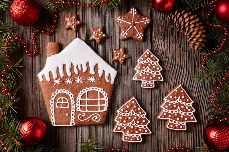 Gingerbread house, fir tree and stars cookies royalty free stock photography