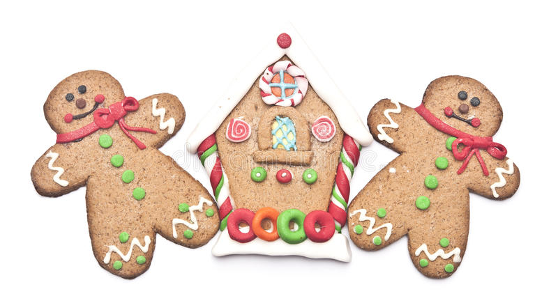 Gingerbread house with gingerbread man. On white background stock photos