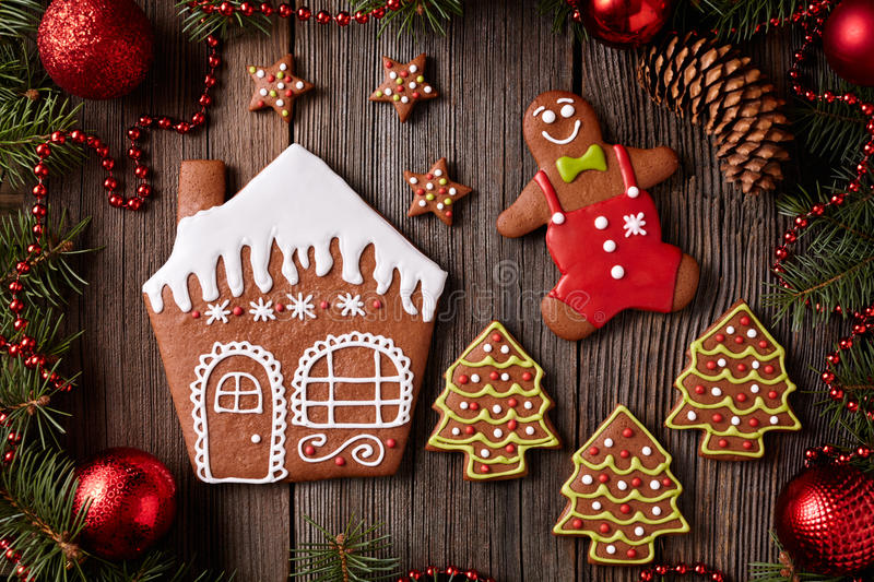 Gingerbread house, man, stars and fir trees stock photos