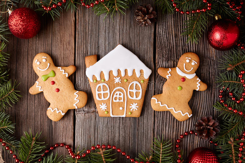 Gingerbread house, man and woman cookies royalty free stock photography
