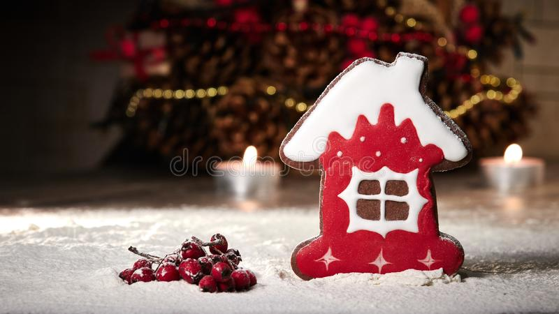 Gingerbread house and rowan berries. Snow, candles and Christmas tree.  royalty free stock image
