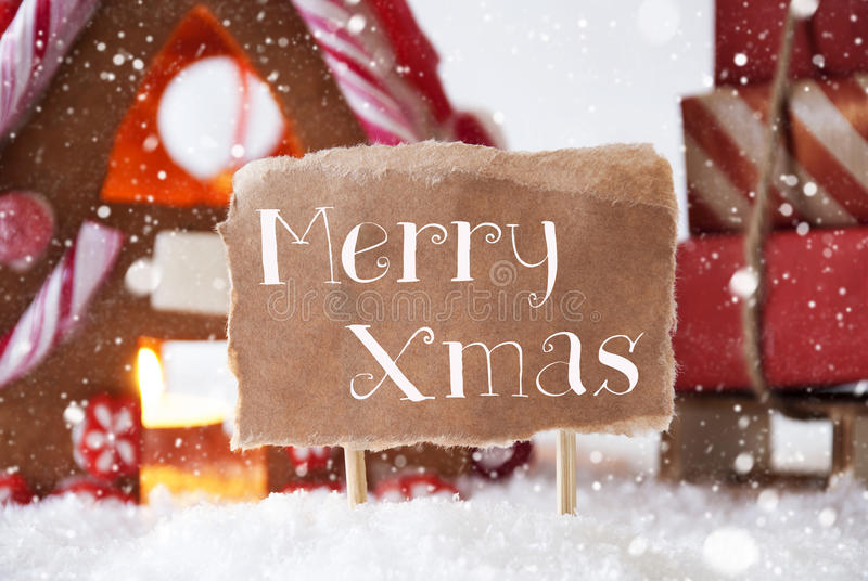 Gingerbread House With Sled, Snowflakes, Text Merry Xmas royalty free stock photos