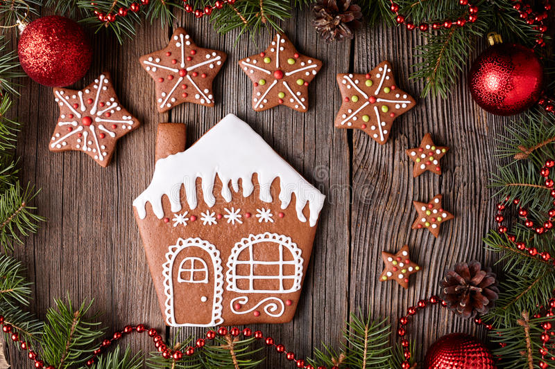 Gingerbread house and star cookies christmas royalty free stock image