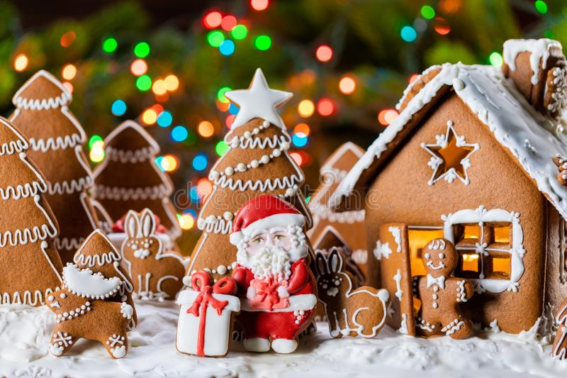 Gingerbread house and trees stock images