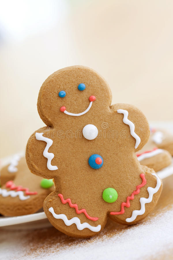Gingerbread man. Smiling gingerbread man with brightly colored buttons stock images