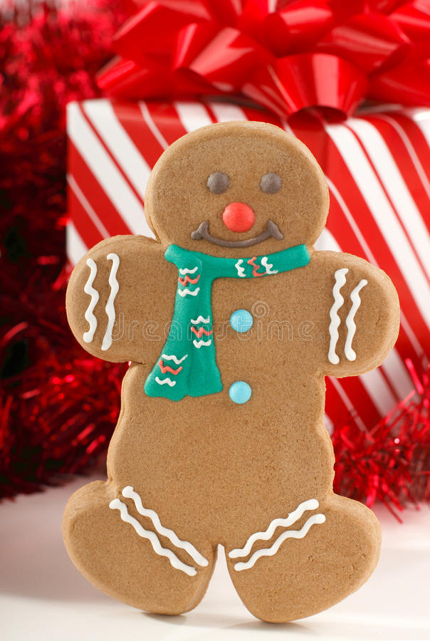 Gingerbread Man. Standing In Front Of Red Christmas Gifts And Decorations stock photos