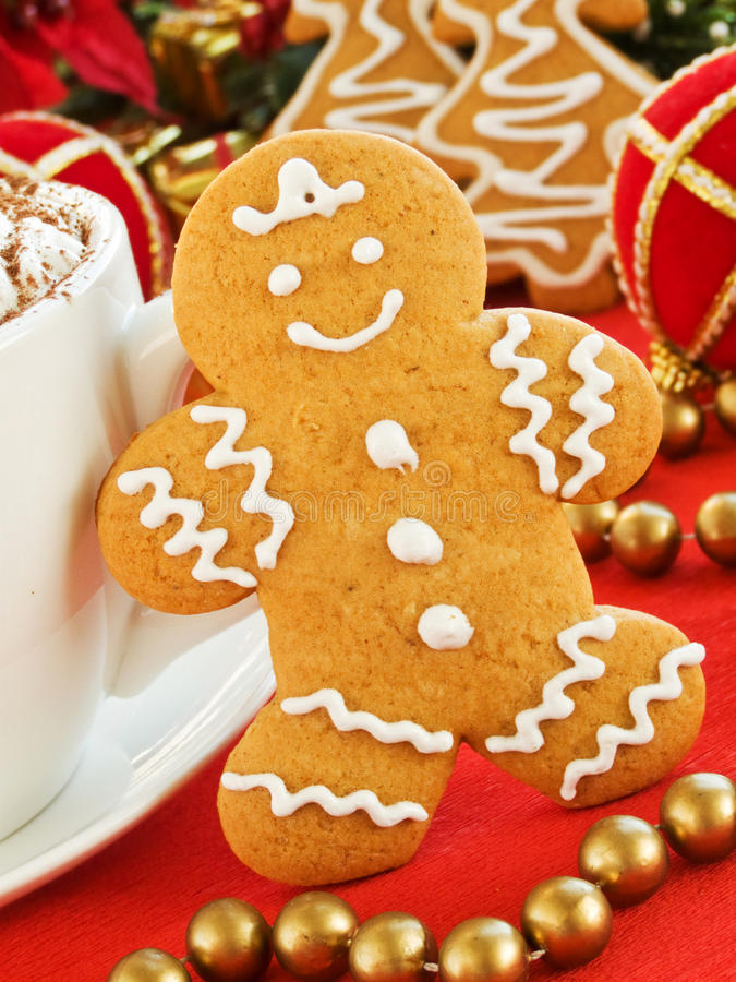 Gingerbread man. Homemade gingerbread man cookie and cup of chocolate with whipped cream. Shallow dof royalty free stock images