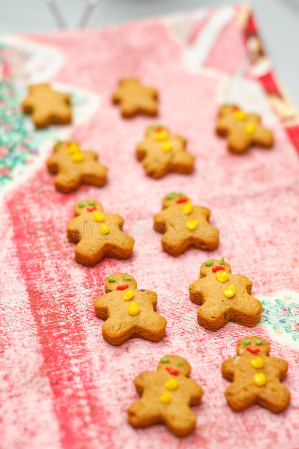 Gingerbread man. Cookies cooling on a table cloth royalty free stock image