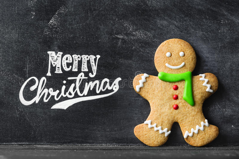 Gingerbread man. Against chalkboard background stock photo