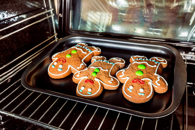 Gingerbread man. Baking Gingerbread man in the oven. Cooking in the oven royalty free stock photography