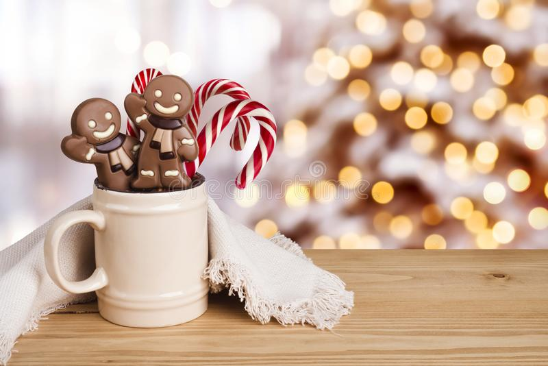 Gingerbread man and candy in dish over abstract holiday background.  royalty free stock photos