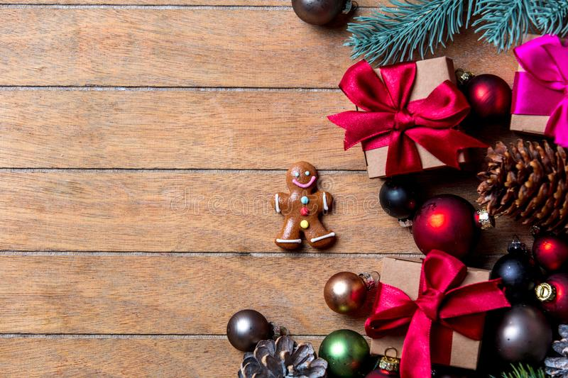 Gingerbread man with Christmas decoration. On wooden table. Above view in old color style royalty free stock images