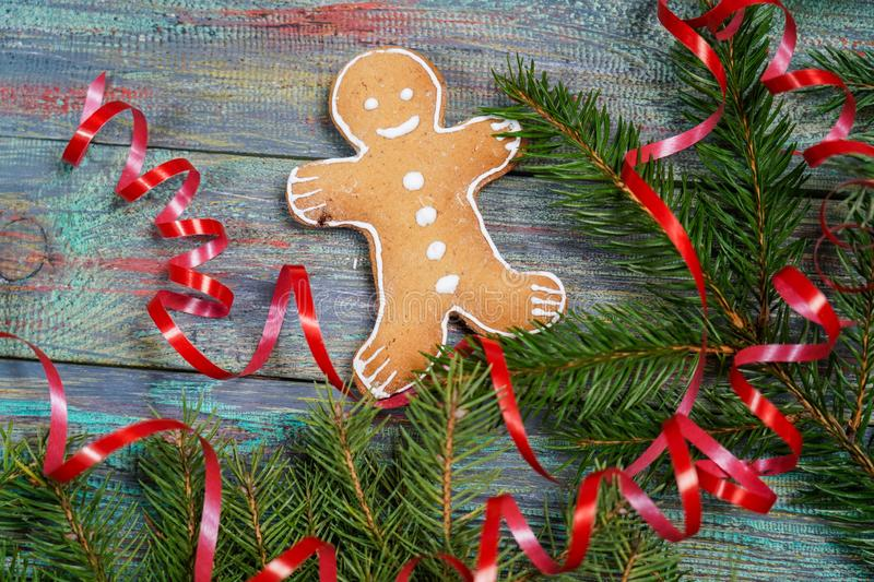 A gingerbread man with Christmas decorations and lots of fir bra royalty free stock images
