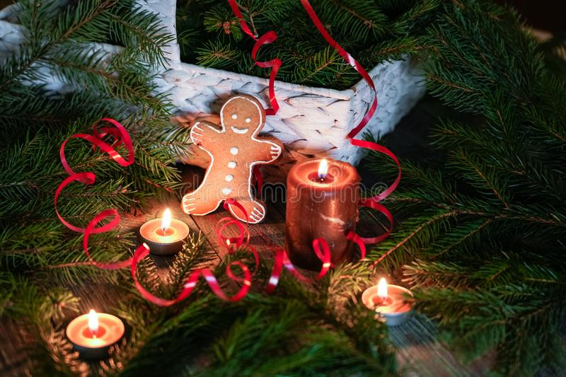 A gingerbread man with Christmas decorations and lots of fir bra. Nches. Christmas gift box. Holiday greeting card. Copy spase, spase for text stock image