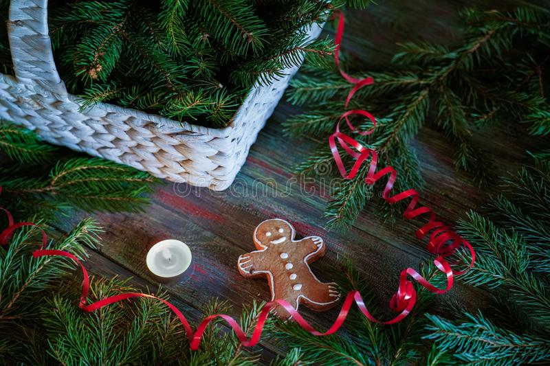 A gingerbread man with Christmas decorations and lots of fir branches. Christmas gift box. Holiday greeting card. Copy spase, spase for text stock photos