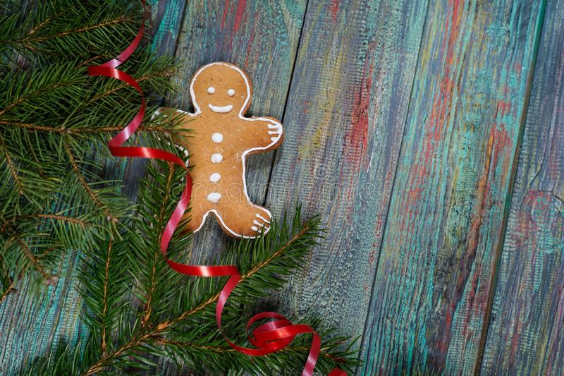 A gingerbread man with Christmas decorations and lots of fir bra royalty free stock photos
