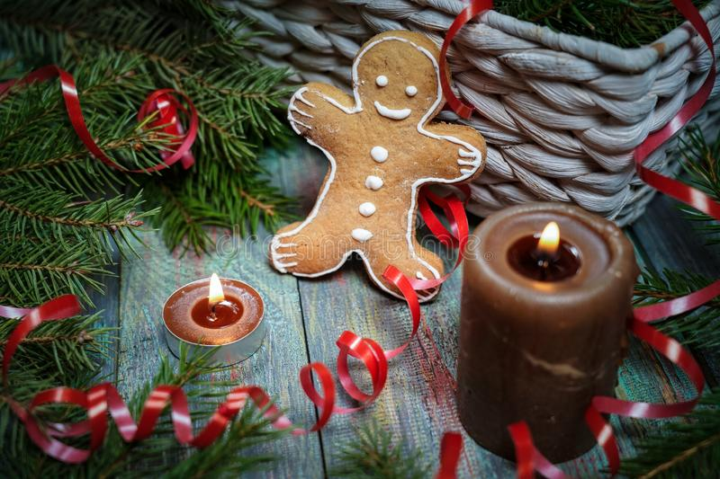 A gingerbread man with Christmas decorations and lots of fir bra. Nches. Christmas gift box. Holiday greeting card. Copy spase, spase for text stock photography
