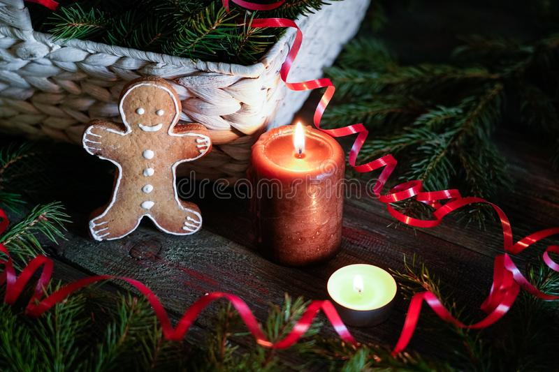 A gingerbread man with Christmas decorations and lots of fir bra stock images