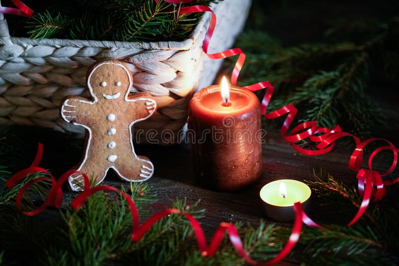 A gingerbread man with Christmas decorations and lots of fir bra stock photography