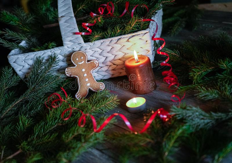 A gingerbread man with Christmas decorations and lots of fir bra stock photos