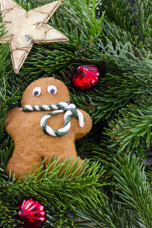 A gingerbread man with Christmas decorations royalty free stock photography
