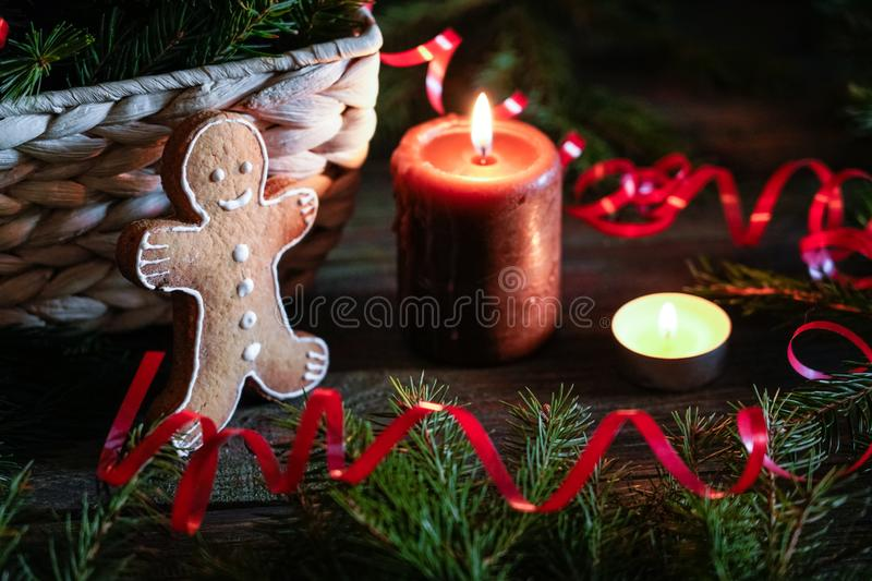 A gingerbread man with Christmas decorations and lots of fir branches stock photos