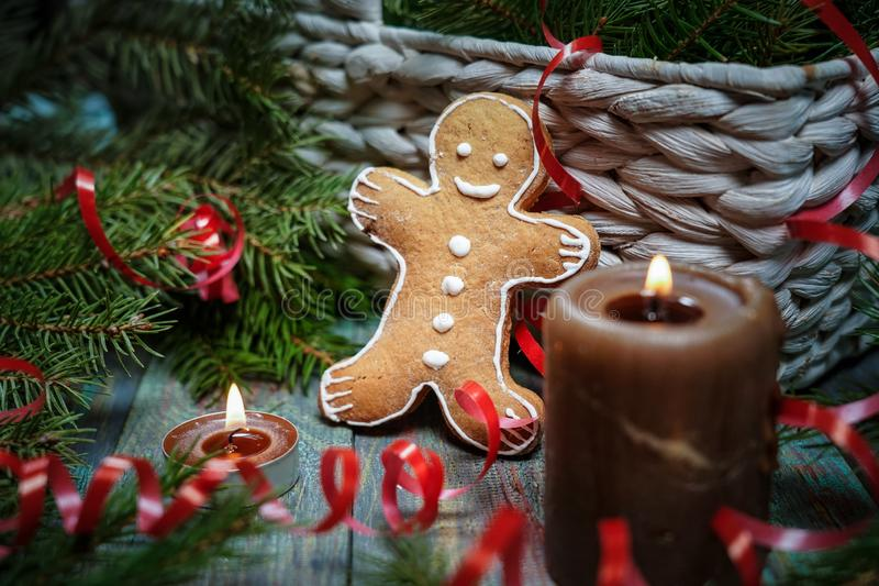 A gingerbread man with Christmas decorations and lots of fir branches. Christmas gift box. Holiday greeting card. Copy spase, spase for text royalty free stock photography