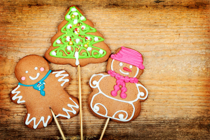 The gingerbread man. Christmas gingerbread man on old wooden background royalty free stock image
