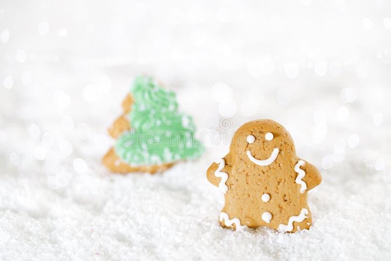 Gingerbread man and christmas tree on a festive Christmas snow. Background, nice postcard stock photography
