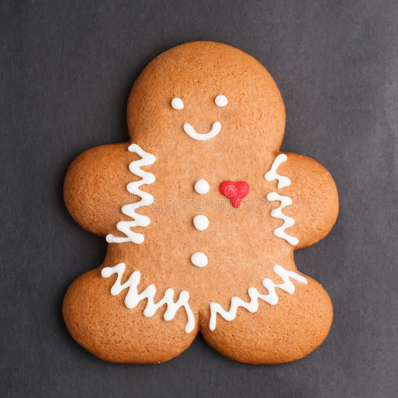Gingerbread man. Cookie against black background royalty free stock photo