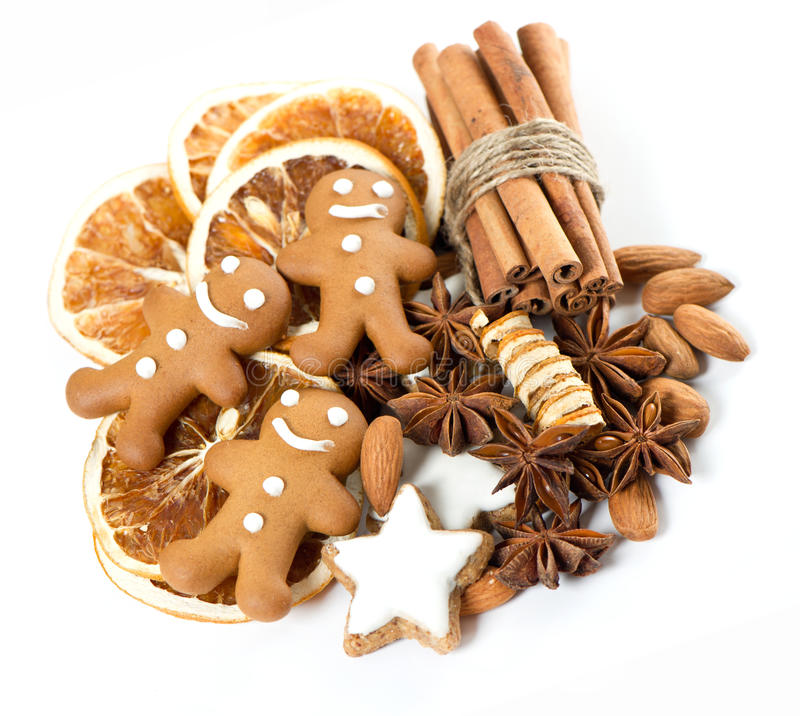Gingerbread man cookies with cinnamon sticks royalty free stock photography