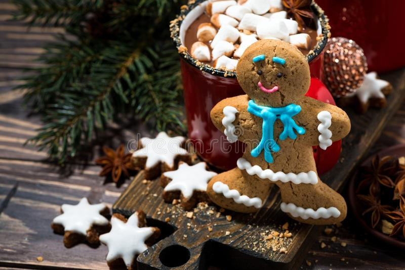 Gingerbread man cookies and hot chocolate, top view. Horizontal royalty free stock photos