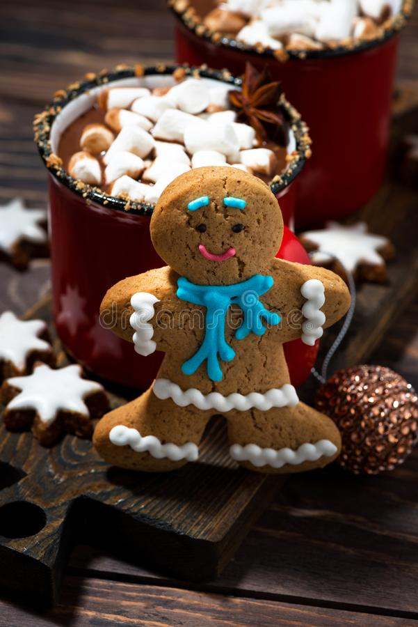 Gingerbread man cookies and hot chocolate, vertical top view. Gingerbread man cookies and hot chocolate, top view royalty free stock photography