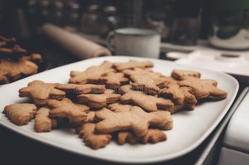 Gingerbread man cookies on the white plate. Gingerbread man cookies on the white plate stock image