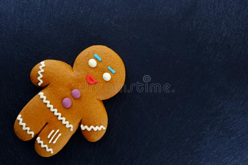 Gingerbread Man on dark background. Christmas or New Year composition. Christmas card royalty free stock photo
