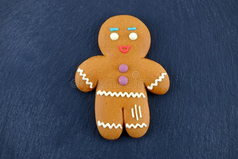 Gingerbread Man on dark background. Christmas or New Year composition.  royalty free stock photos